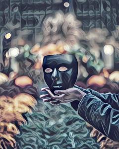 Foto de una máscara negra sobre unas manos